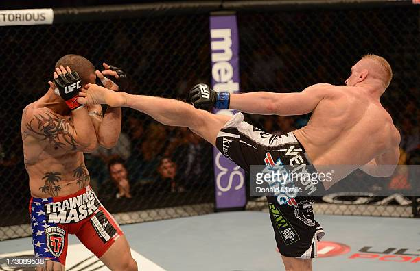 Dennis Siver kicks Cub Swanson in their featherweight fight during the UFC 162 event inside the MGM Grand Garden Arena on July 6, 2013 in Las Vegas,...