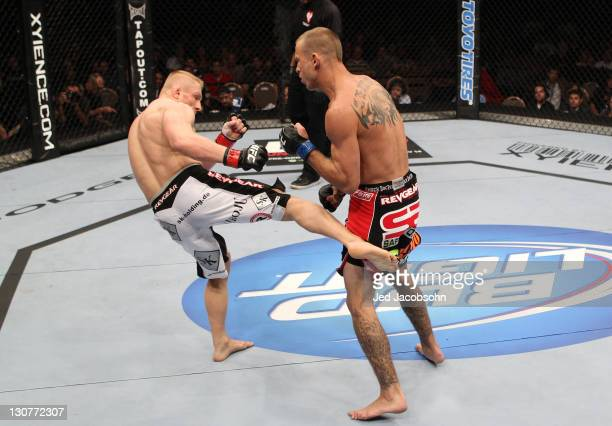 Dennis Siver kicks Donald Cerrone during the UFC 137 event at the Mandalay Bay Events Center on October 29, 2011 in Las Vegas, Nevada.