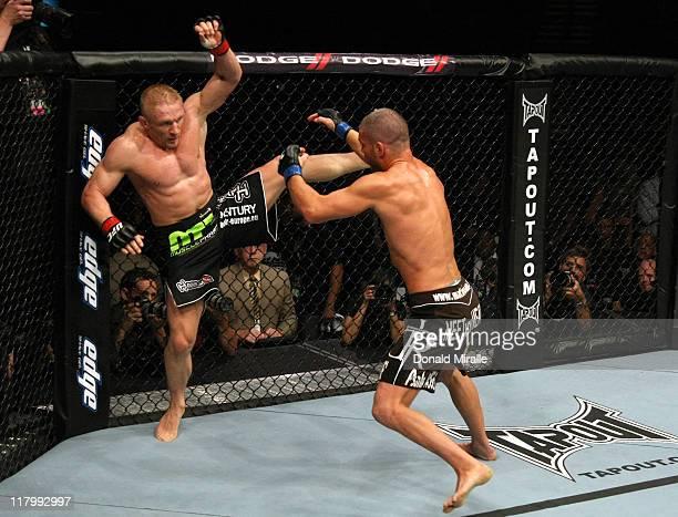 Dennis Siver kicks Matt Wiman during a lightweight bout at UFC 132 at MGM Grand Garden Arena on July 2, 2011 in Las Vegas, Nevada.