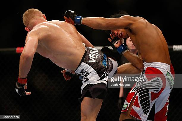 Dennis Siver kicks Nam Phan during their featherweight bout at the UFC on FOX event on December 8 2012 at Key Arena in Seattle Washington