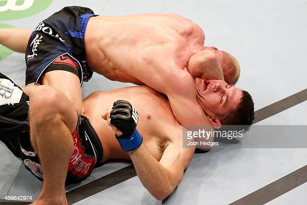 Dennis Siver of Germany attempts to secure an arm triangle choke submission against Charles Rosa in their featherweight bout at the Ericsson Globe...