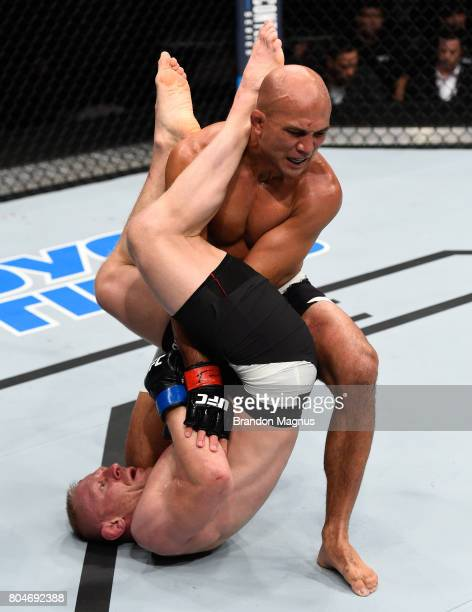 Dennis Siver of Germany attempts to submit BJ Penn in their featherweight bout during the UFC Fight Night event at the Chesapeake Energy Arena on...