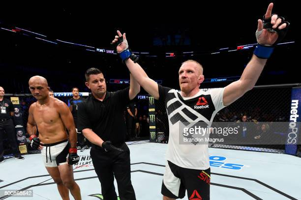 Dennis Siver of Germany celebrates after his majoritydecision victory over BJ Penn in their featherweight bout during the UFC Fight Night event at...