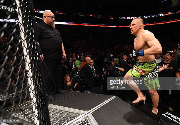 Dennis Siver of Germany enters the Octagon before a featherweight fight against Conor McGregor of Ireland during the UFC Fight Night event at the TD...