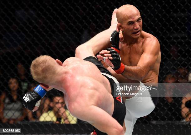 Dennis Siver of Germany kicks BJ Penn in their featherweight bout during the UFC Fight Night event at the Chesapeake Energy Arena on June 25 2017 in...