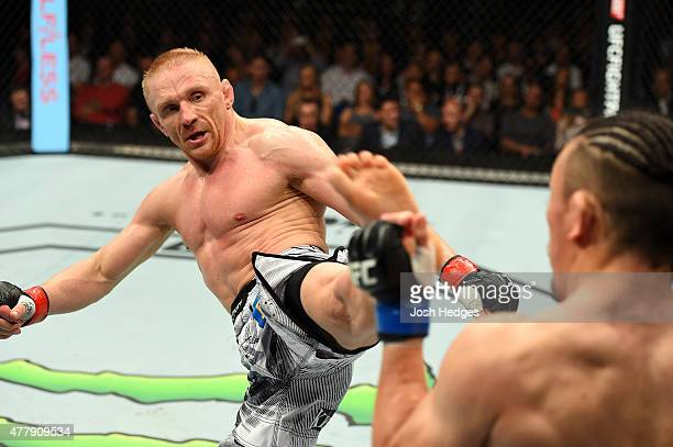 Dennis Siver of Germany kicks Tatsuya Kawajiri of Japan in their featherweight bout during the UFC Fight Night event at the O2 World on June 20 2015...