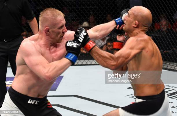 Dennis Siver of Germany punches BJ Penn in their featherweight bout during the UFC Fight Night event at the Chesapeake Energy Arena on June 25 2017...