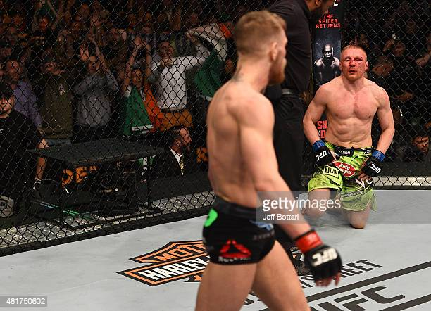Dennis Siver of Germany reacts after being defeated by Conor McGregor of Ireland in their featherweight fight during the UFC Fight Night event at the...