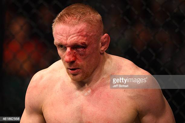 Dennis Siver of Germany walks back to his corner after round one against Conor McGregor of Ireland in their featherweight fight during the UFC Fight...