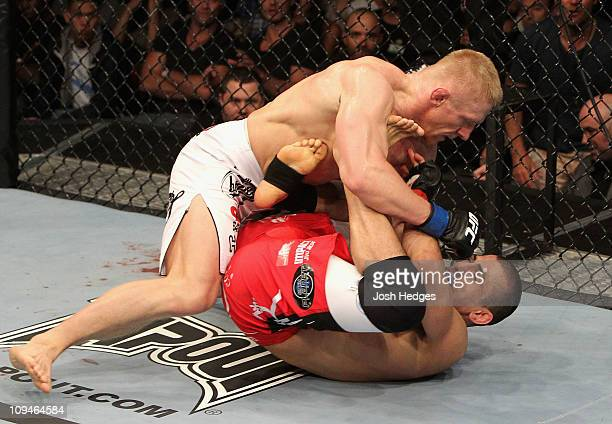 Dennis Siver of Russia punches George Sotiropoulos of Australia during their Lightweight bout at UFC 127 at Acer Arena on February 27 2011 in Sydney...