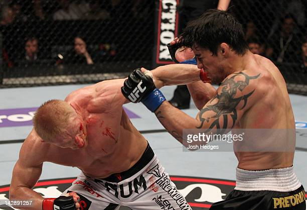 Dennis Siver punches Diego Nunes during their featherweight bout at the UFC on Fuel TV event at Ericsson Globe on April 14, 2012 in Stockholm, Sweden.