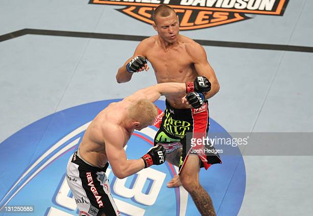 Dennis Siver punches Donald Cerrone during the UFC 137 event at the Mandalay Bay Events Center on October 29, 2011 in Las Vegas, Nevada.