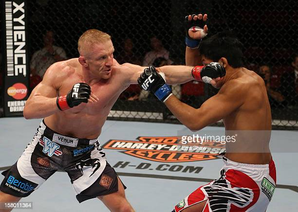 Dennis Siver punches Nam Phan during their featherweight bout at the UFC on FOX event on December 8 2012 at Key Arena in Seattle Washington