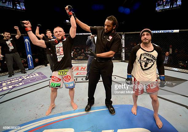 Dennis Siver reacts to his victory over Manny Gamburyan in their featherweight bout during the UFC 168 event at the MGM Grand Garden Arena on...