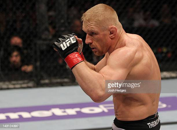 Dennis Siver stands in the Octagon during his bout against Diego Nunes at the UFC on Fuel TV event at Ericsson Globe on April 14, 2012 in Stockholm,...