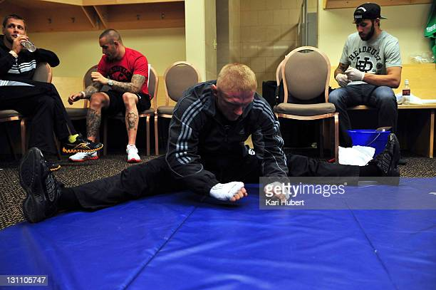 Dennis Siver stretches in his locker room before his bout against Donald Cerrone during the UFC 137 event at the Mandalay Bay Events Center on...