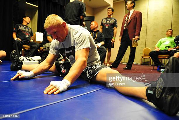 Dennis Siver warms up backstage in his locker room before his bout with Matt Wiman at UFC 132 inside the MGM Grand Garden Arena on July 2, 2011 in...