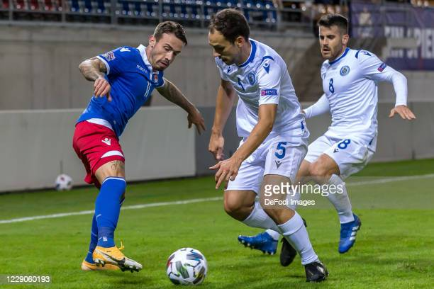 Dennis Slanovic of Liechtenstein, Christian Brolli of San Marino and Enrico Golinucci of San Marino battle for the ball during the UEFA Nations...