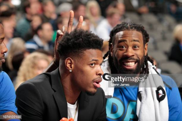 Dennis Smith Jr #1 and Deandre Jordan of the Dallas Mavericks are photographed from the bench during the game against the Orlando Magic on December...