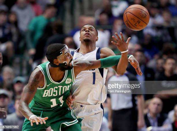 Dennis Smith Jr #1 of the Dallas Mavericks and Kyrie Irving of the Boston Celtics battle for the ball at American Airlines Center on November 20 2017...
