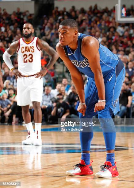 Dennis Smith Jr #1 of the Dallas Mavericks and Lebron James of the Cleveland Cavaliers look on during the game on Novemeber 11 2017 at the American...