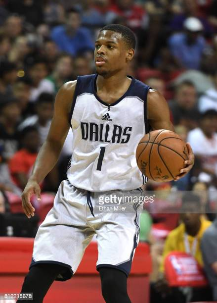 Dennis Smith Jr #1 of the Dallas Mavericks brings the ball up the court against the Phoenix Suns during the 2017 Summer League at the Thomas Mack...