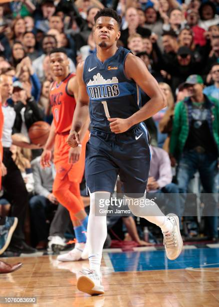 Dennis Smith Jr #1 of the Dallas Mavericks celebrates after play against the Oklahoma City Thunder on December 30 2018 at the American Airlines...