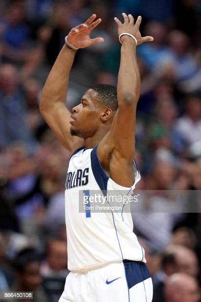 Dennis Smith Jr #1 of the Dallas Mavericks celebrates after scoring against the Memphis Grizzlies in the second half at American Airlines Center on...