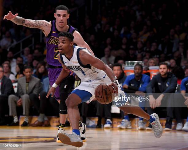 Dennis Smith Jr #1 of the Dallas Mavericks dribbles past Lonzo Ball of the Los Angeles Lakers during the first half at Staples Center on November 30...