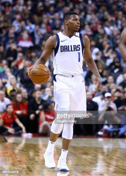 Dennis Smith Jr #1 of the Dallas Mavericks dribbles the ball during the first half of an NBA game against the Toronto Raptors at Air Canada Centre on...
