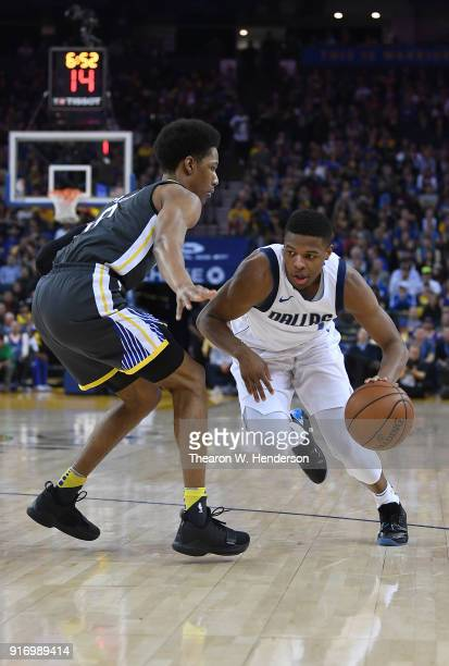 Dennis Smith Jr #1 of the Dallas Mavericks dribbles the ball while guarded closely by Patrick McCaw of the Golden State Warriors during an NBA...