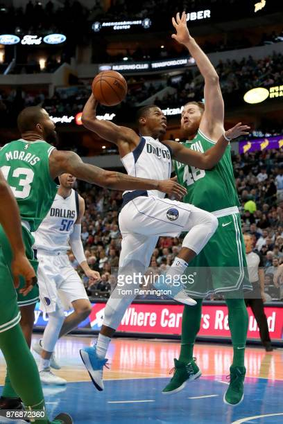Dennis Smith Jr #1 of the Dallas Mavericks drives to the basket against Aron Baynes of the Boston Celtics in the first half at American Airlines...