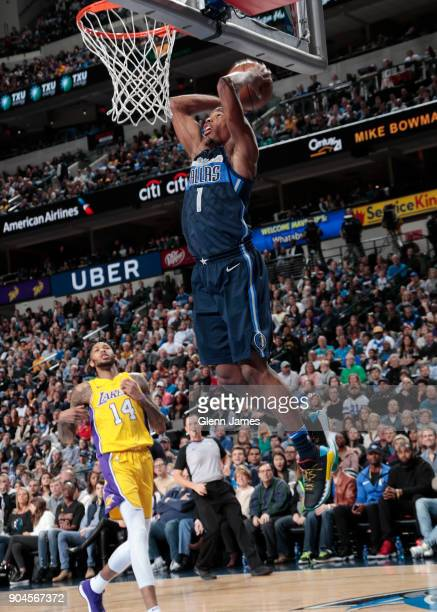 Dennis Smith Jr #1 of the Dallas Mavericks dunks against the Los Angeles Lakers on January 13 2018 at the American Airlines Center in Dallas Texas...
