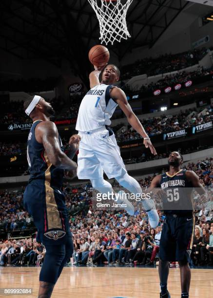 Dennis Smith Jr #1 of the Dallas Mavericks dunks against the New Orleans Pelicans on November 3 2017 at the American Airlines Center in Dallas Texas...
