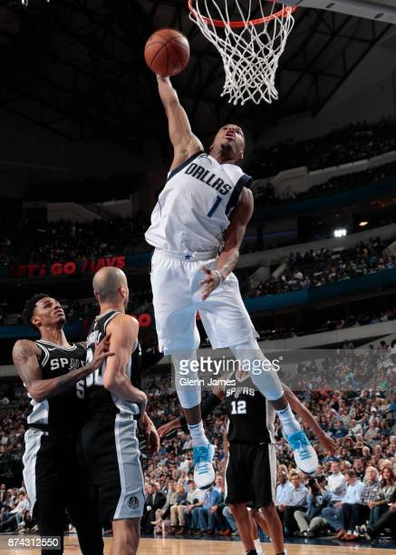 Dennis Smith Jr #1 of the Dallas Mavericks dunks against the San Antonio Spurs on November 14 2017 at the American Airlines Center in Dallas Texas...
