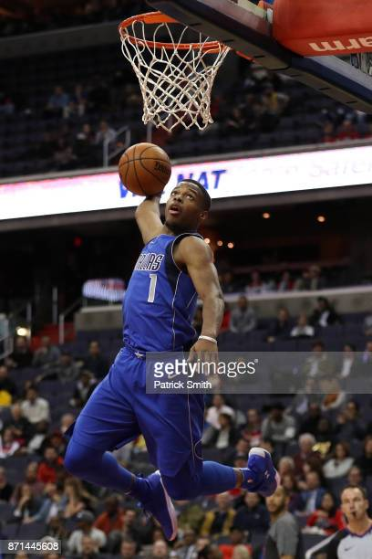 Dennis Smith Jr #1 of the Dallas Mavericks dunks against the Washington Wizards during the first half at Capital One Arena on November 7 2017 in...