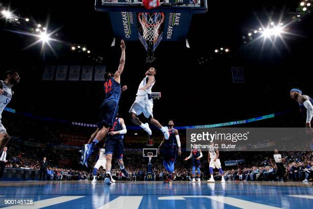 Dennis Smith Jr #1 of the Dallas Mavericks dunks the ball during the game against the Oklahoma City Thunder on December 31 2017 at Chesapeake Energy...