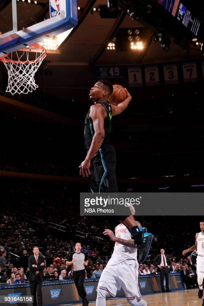 Dennis Smith Jr #1 of the Dallas Mavericks dunks the ball during the game against the New York Knicks on March 13 2018 at Madison Square Garden in...