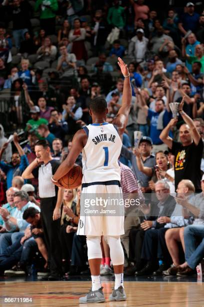 Dennis Smith Jr #1 of the Dallas Mavericks gets the crowd into the game against the Memphis Grizzlies on October 25 2017 at the American Airlines...