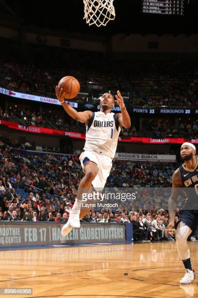 Dennis Smith Jr #1 of the Dallas Mavericks goes to the basket against the New Orleans Pelicans on December 29 2017 at Smoothie King Center in New...