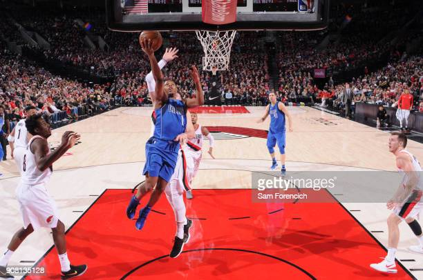 Dennis Smith Jr #1 of the Dallas Mavericks goes to the basket against the Portland Trail Blazers on January 20 2018 at the Moda Center in Portland...