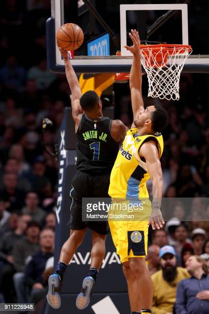 Dennis Smith Jr #1 of the Dallas Mavericks goes to the basket against Trey Lyles of the Denver Nuggets at the Pepsi Center on January 27 2018 in...