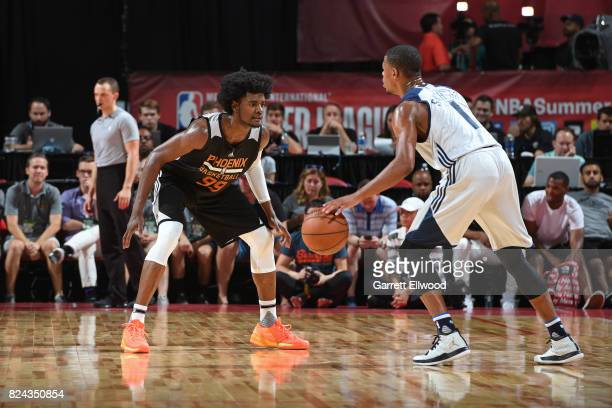 Dennis Smith Jr #1 of the Dallas Mavericks handles the ball against Josh Jackson of the Phoenix Suns during the 2017 Summer League on July 9 2017 at...