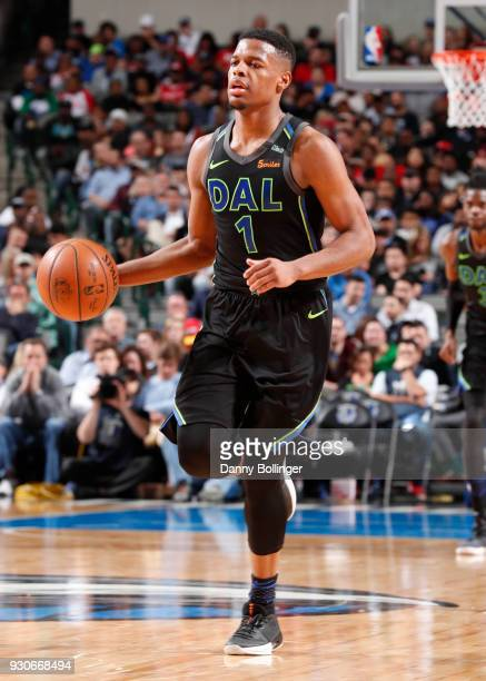Dennis Smith Jr #1 of the Dallas Mavericks handles the ball against the Houston Rockets on March 11 2018 at the American Airlines Center in Dallas...