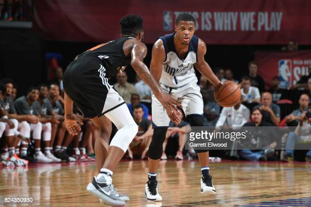 Dennis Smith Jr #1 of the Dallas Mavericks handles the ball during the game against Derrick Jones Jr #10 of the Phoenix Suns during the 2017 Summer...