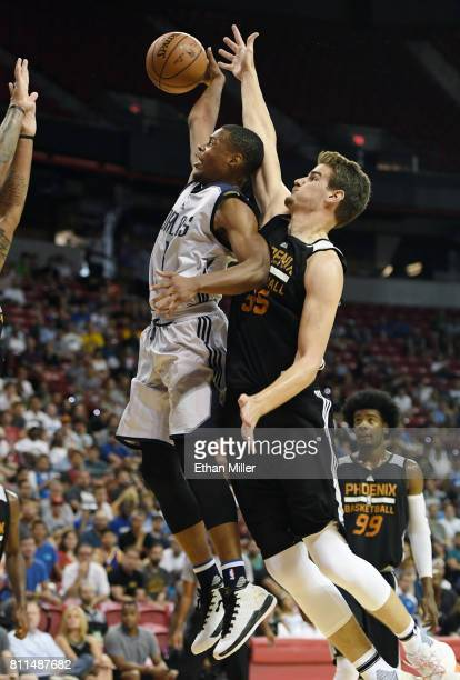 Dennis Smith Jr #1 of the Dallas Mavericks is fouled by Dragan Bender of the Phoenix Suns during the 2017 Summer League at the Thomas Mack Center on...