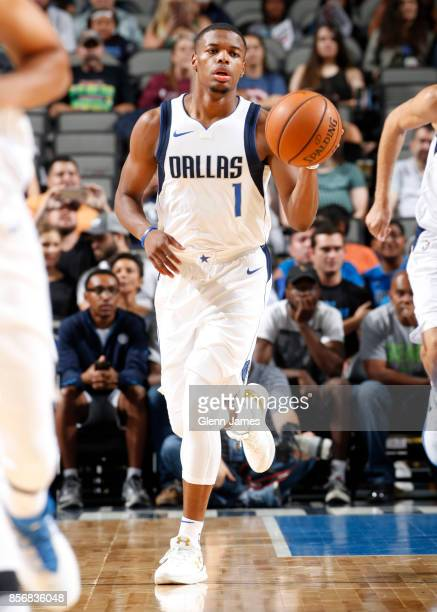 Dennis Smith Jr #1 of the Dallas Mavericks looks on during the preseason game against the Milwaukee Bucks on October 2 2017 at the American Airlines...