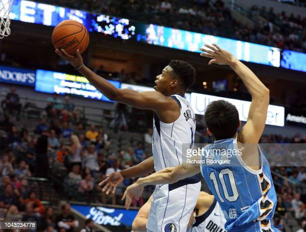 Dennis Smith Jr #1 of the Dallas Mavericks puts up a shot against Liu Xiaoyu of the Beijing Ducks in the second quarter of a preseason game at...