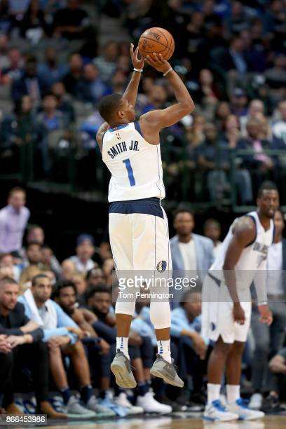 Dennis Smith Jr #1 of the Dallas Mavericks shoots a three point shot against the Memphis Grizzlies in the second half at American Airlines Center on...