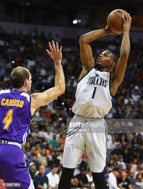 Dennis Smith Jr #1 of the Dallas Mavericks shoots against Alex Caruso of the Los Angeles Lakers during a semifinal game of the 2017 Summer League at...